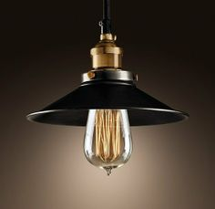 ADVERTISEMENT: ADVERTISEMENT: Though simple Edison bulb pendants may have been designated for basement scenes in Boardwalk Empire, we're envisioning a pair of these Metal Filament Pendants With Aged Steel ($119) hanging above a kitchen island.
