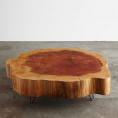 A solid sequoia crosscut tabletop  with black steel wire hoop legs. We salvaged this tree in Seattle.
