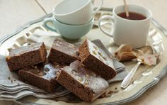 Top squares of this spiced cake, a perfect dessert for holiday meals and parties, with spoonfuls of whipped cream, if you like. The crystallized ginger gives them an extra punch.