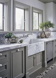 grey cabinets and white marble counter top three olives the kitchen