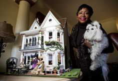A New Orleans dollhouse gets a makeover in miniature |Cheryl Teamer, holding her dog, Sophie, stands next to her current project, a 29-inch-tall house depicting 1840s domestic life in New Orleans.