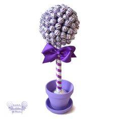 A purple lollipop topiary makes a sweet centerpiece for your wedding, birthday or baby shower. Standing at ~17 inches tall and ~4 inches wide with