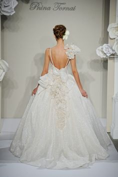 Pnina Tornai #wedding  Like the frou-frou, but the bow is almost too much.  Makes the dress look dated