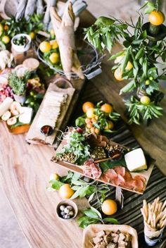 The greenery surrounding the charcuterie board gives it a nice natural feeling