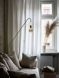 Moody Swedish apartment with Pampas grass as décor. Minimal living room in beige tones.