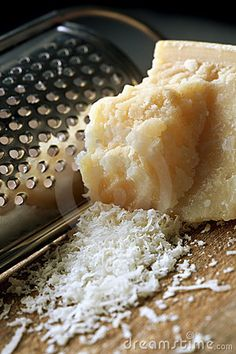 Grating Parmesan Cheese by Robyn Mackenzie, via Dreamstime
