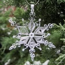 Image result for quilled snowflakes