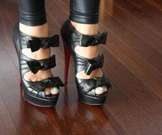 I'd totally rock these. Love the feminine bows but edgy fabric.