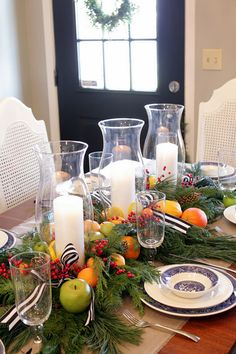 Burlap under Christmas greens and fruit: blue willow