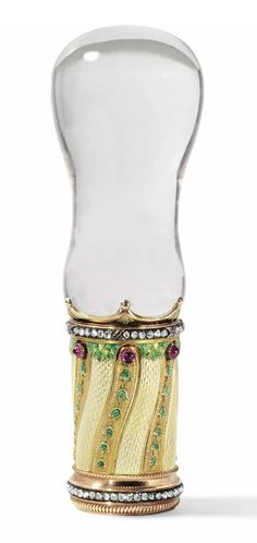 Fabergé jewelled two-colour gold-mounted, guilloché enamel and rock crystal cane handle by workmaster Michael Perchin, St Petersburg, ca.1890. Bulbous handle above a mount with wavy bands of translucent white over hatched guilloché ground. This alternates with trails of bellflowers on gold-stippled ground surmounted by ruby cabochons. Rose-cut diamonds circle lower border