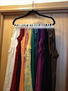 A cute and inexpensive way to store your tank tops. Simply use a hanger and shower curtain rings. Get the hanger from your closet, and the curtain rings from your local dollar store. Saves drawer and closet space! Tank Top Organization, Storage Organization, Storage Hacks, Organizing Ideas, Rv Storage, Trailer Organization, Organizing Solutions, Organising, Paper Storage