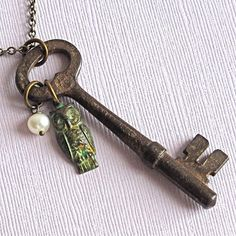 Silvery jumbo skeleton key with turquoise color and earthy beads silvery jumbo skeleton key with turquoise color and earthy beads long necklace knotted on leather earthy skeletons and key aloadofball Images