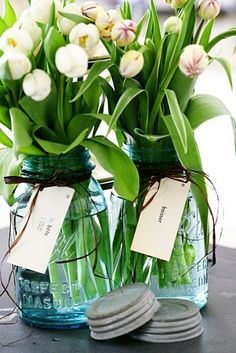 Outdoor Easter table centerpieces - Tall white tulips in clear mason jars