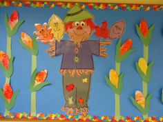 Fall scarecrow bulletin board at Trinity Preschool. The children painted bubble wrap with fall colors and then we cut it into corn shapes for our bulletin board.