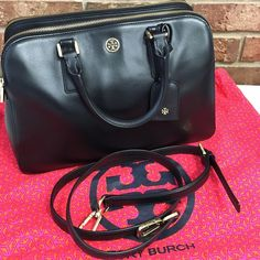 AUTH Tory Burch Triple Zip Satchel ‼️ NO TRADES ‼️ FIRM PRICE ON POSH ‼️ This is an authentic Tory Burch Robinson Triple Zip Satchel in black Saffiano leather with gold hardware and Crossbody strap. Please google that style for stock photos and additional details. Cross listed on a popular site - will go fast! In like new condition! Dust bag included! Note this bag has been discontinued and is sold out everywhere  TRADE REQUESTS AND OFFERS WILL BE IGNORED  SPECIAL PRICE GOOD FOR TODAY FEB 7…