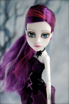This listing is for a repainted Monster High doll. She was originally a Spectra Vondergeist doll from the Ghouls Night Out line.    The original