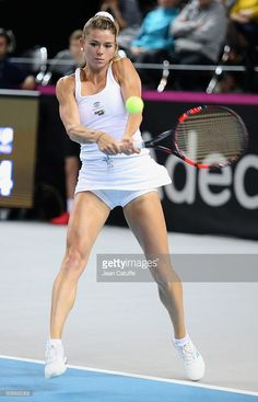Camila Giorgi of Italy in action during day 2 of the Fed Cup World Group tie between France and Italy at Palais des Sports on February 2016 in Marseille, France. (Photo by Jean Catuffe/Getty Images) Camila Giorgi, Fed Cup, Tennis Players Female, These Girls, Tennis Racket, Athlete, Beautiful Women, Action, Italy