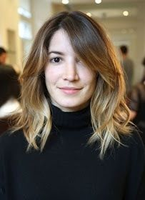 Shoulder length style; layered with sharp (maybe razor cut?) ends, angles and long bangs starting just above the chin, piece-y effect that I love