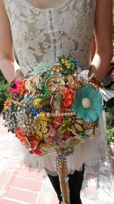 would be really cute to have bridal shower/engagement party guests bring a pin or brooch instead of using bows/ribbons on gifts and use that for the rehearsal bouquet! Love this idea. So doing it for my wedding Broach Bouquet, Diy Bouquet, Peonies Bouquet, Beaded Bouquet, Blue Peonies, Our Wedding, Wedding Gifts, Dream Wedding, Bling Wedding