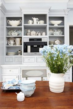 I do like this open shelving sans glass fronts  also its a good place for tea/coffee center  Sarah Richardson London Flat Kitchen
