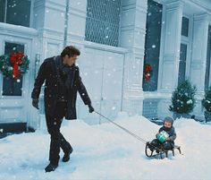 From the hunky dad pulling his adorable son on a sleigh to the rather large Tiffany box...what is there not to LOVE!?!?!