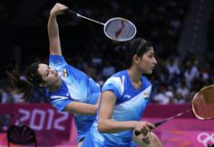India's Jwala Gutta, left, and Ashwini Ponnappa play against Japan's Mizuki Fujii and Reika Kakiiwa, unseen, at a women's doubles badminton match of the 2012 Summer Olympics, Saturday, July 28, 2012, in London.