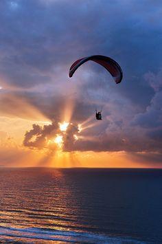 https://flic.kr/p/fh3DZm | Atravesando las nubes | paragliding at sunset on sea with sun beams. Sopelana, Basque Country, Spain