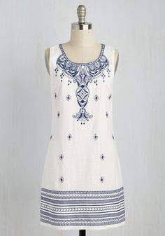 Save a spot in your suitcase for this shift dress, and you'll find it was well worth it! Like the Santorini landscape, this frock's royal blue embroidery captivates atop a pristine white spread. Plus, a cool linen-cotton blend gives this special number even more coastal charm!