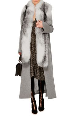 A warm overcoat lined in arctic fox fur by **Jonathan Simkhai** is rendered in an ankle-length construction perfect for every day or evening wear.