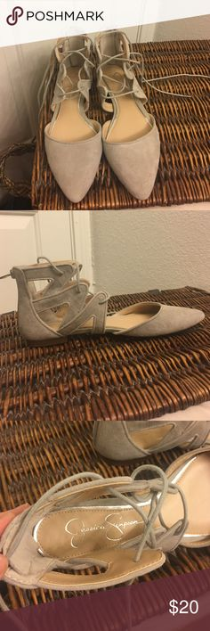 Adorable lace-up ballet flats [[Jessica Simpson]] Soft dove-grey flats. Feels like suede. Lace them up and look super cute! The back is zip-up, which is neat. They were a gift, but are a little too small for me. 😰 these might fit best for a size 7! Jessica Simpson Shoes Flats & Loafers
