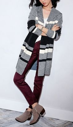 Bold stripes give on-trend blanket appeal to this stylish sweater-knit coat.