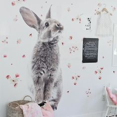 Bunny Wall Sticker - Free Domestic Shipping Over $99 USD. Each order includes 1 large bunny wall decal and 18 flower petals. Order today from UrbanWalls.