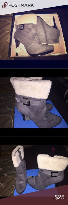 NWT Gray Ankle Boots by Traffic Up for sale are a brand new pair of gray ankle boots by Traffic. Never worn and super comfortable despite the heel height. I have way too much stuff in my closet lol. Traffic Shoes Ankle Boots & Booties
