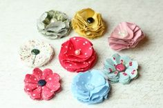 make fabric flowers puffy style many colors   http://www.homemade-gifts-made-easy.com/make-fabric-flowers.html#