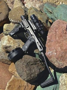 Glock 17 with drum in Fab Defense carbine converter Find our speedloader now!  http://www.amazon.com/shops/raeind