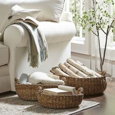 Good way to keep a handle on clutter next to the couch.  Seagrass Shallow Baskets with Handles