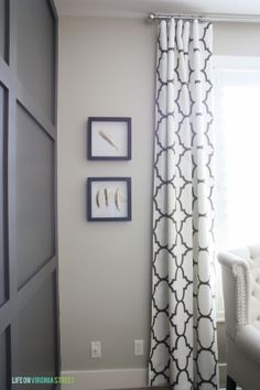 Curtain Panels//wall color Behr castle path//framed feathers//charcoal gray paneling color Behr urban bronze