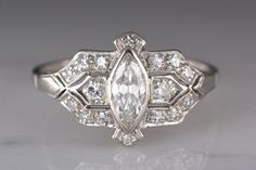 Antique 1920s Post Edwardian / Art Deco Platinum Engagement or Cocktail Ring with Marquise Cut Diamond R755