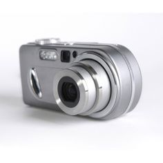 Olympus Stylus 750 7.1MP Digital Camera with Digital Image Stabilized 5x Optical Zoom and CCD Shift Stabilization (Silver)