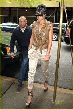 Rihanna: Snakeskin-print ruffled vest