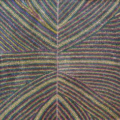 Strings of multicoloured dots depict travelling, dancing and story lines associated with the Yam and Emu Dreaming, framed by smaller white dots. This is the same Yam Dreaming that her Aunt, Emily Kame Kngwarreye was renowned for painting. Rare to find, this style is an old favourite by Dolly who is now into her late 60's.  - exhibition excerpt ------  #aboriginalart #utopialaneart #indigenousart #decorating #colour #art #painting #nativeart #artlover