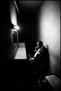 """Musicians don't retire; they stop when there's no more music in them."" Louis Armstrong (seen here in Philadelphia during the last minute of concentration in the wings before appearing in public, 1958)."