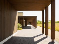 Waugh Thistleton has added a pair of new prayer halls to a Jewish cemetery in Hertfordshire, which features rammed-earth walls. Carlo Scarpa, Halle, Rammed Earth Wall, Contract Design, Wood Architecture, Facade Design, Indoor Air Quality, Built Environment, London