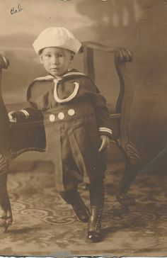 Boy with buttons sailor suit - vintage sepia photo