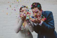 bride and groom blowing confetti kisses!