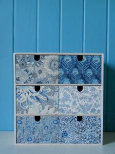 decorate plain IKEA drawers with Liberty (or other) fabric - brilliant idea!