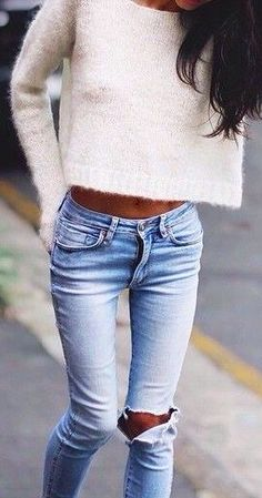 white fuzzy sweater with fitted ripped jeans. fall or spring fashion