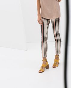 stripped cropped trousers and yellow sandals