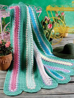 Melting snows reveals colors of the earth's rebirth in green meadows and spring's first blooms, beautifully reflected in this cozy afghan. This e-pattern was originally published in Big Book of Scrap Crochet Afghans.