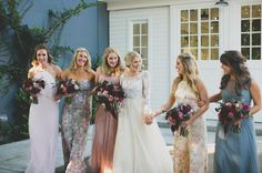 Textured burgundy bouquets with pastel and floral bridesmaids dresses